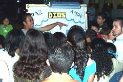 OAC evangelist preaching to a Spanish-speaking crowd